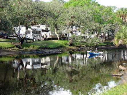 Camper paddles the inlet at Camp Venice