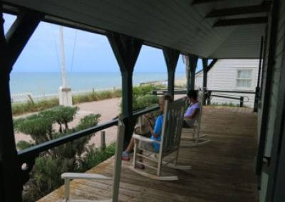 Rocking chairs beckon you to slow down and enjoy the view at Gilbert's Bar House of Refuge, Hutchinson Island.