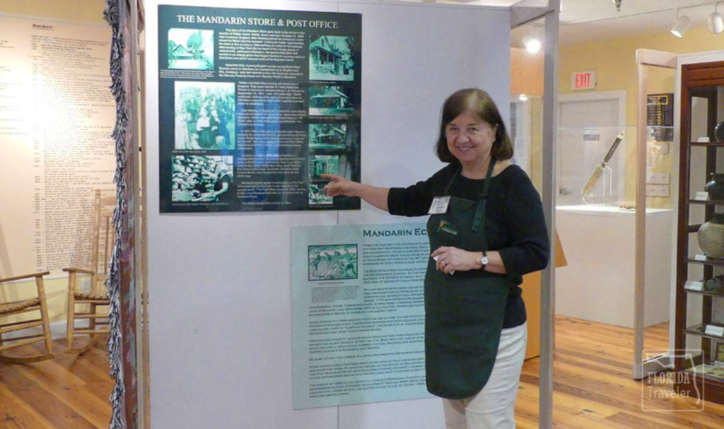 Female docent pointing to exhibit at Walter Jones Park in Mandarin