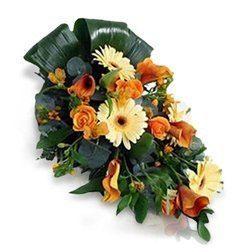 ramo-funerario-en-tonos-amarillos-y-naranjas