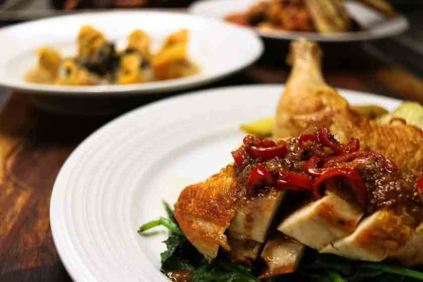 Chicken Bandera: half chicken roasted with citrus whole-grain mustard chili sauce, roasted fingerling potatoes with artichokes, and sauteed spinach. The sauce is amazing!!!!!! Get extra, YUM!