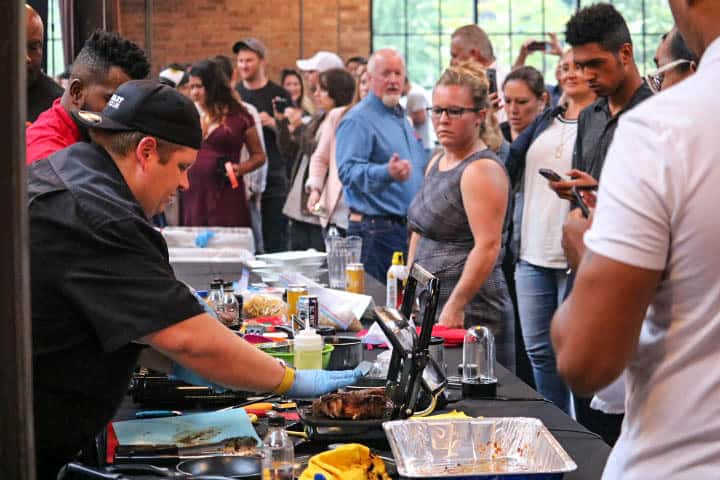Spectators were questioning the chefs as they created their dishes