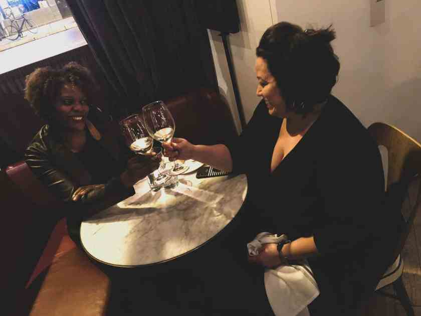 Two women toasting at Cafe Robey restaurant