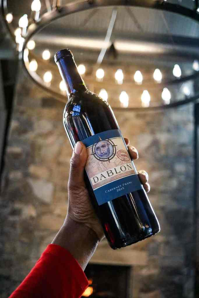 Hand holding a bottle of Cabernet Franc