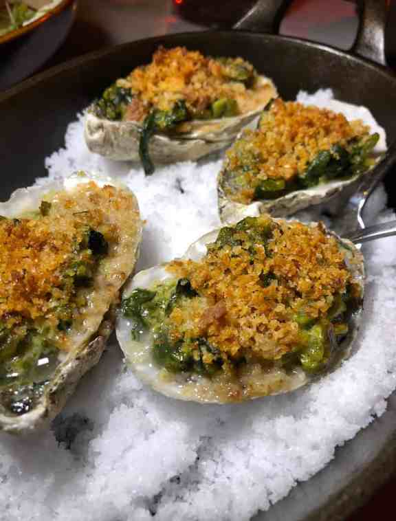oysters Rockefeller, grilled oysters, creamed poblano, parmesan, herb bread crumbs
