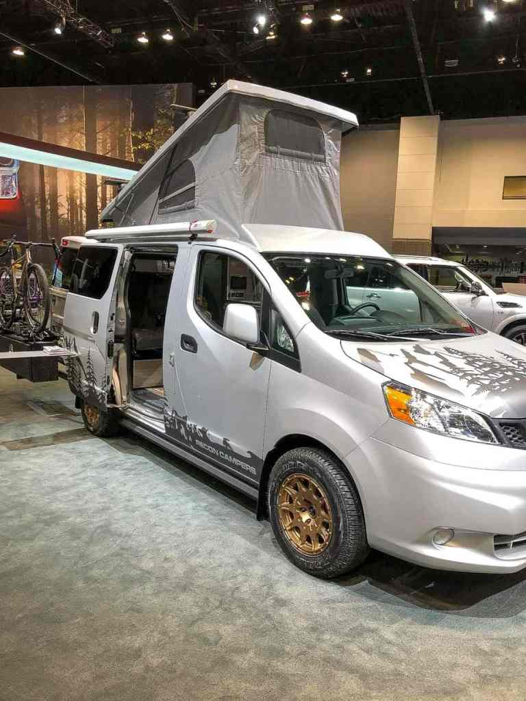 Gray Camper Van that sleeps four and is equipped like an RV