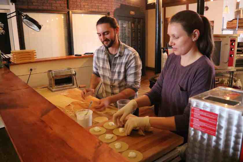 Man and woman making pasta