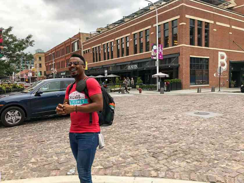 Chicago Food Planet tour guide standing on street