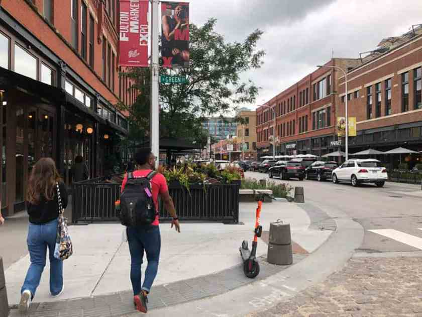 Man and woman walking in West Loop Chicago