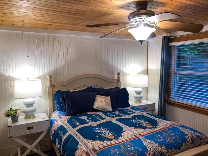 bedroom decorated in blue and white