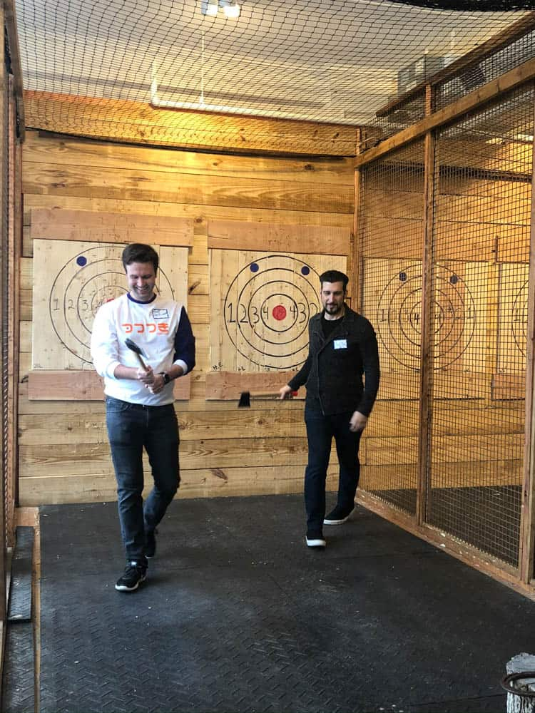 Competitors in axe throwing cage at Ragnarok Axe Throwing