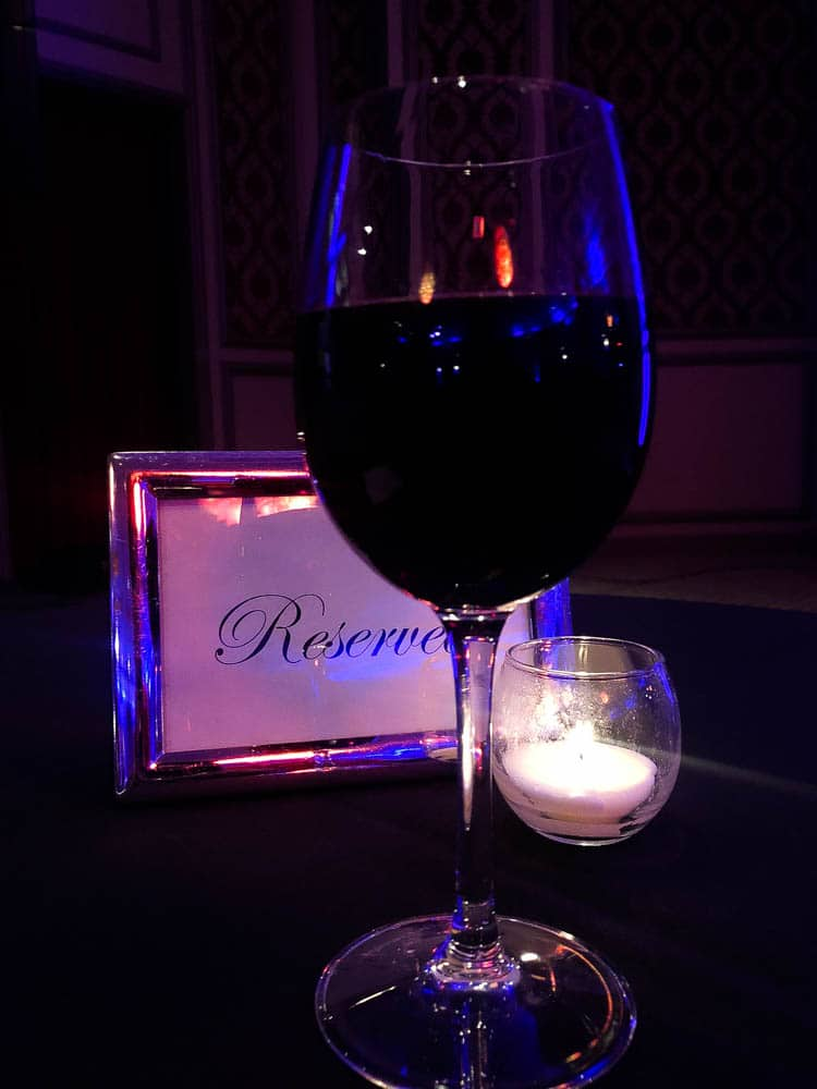 glass of wine and candle on table