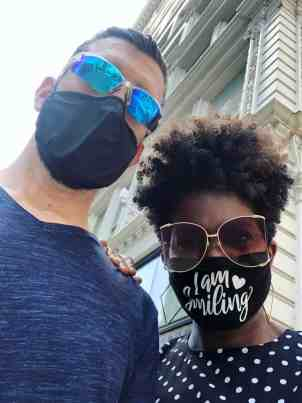 Man and woman wearing masks while on Chicago tour
