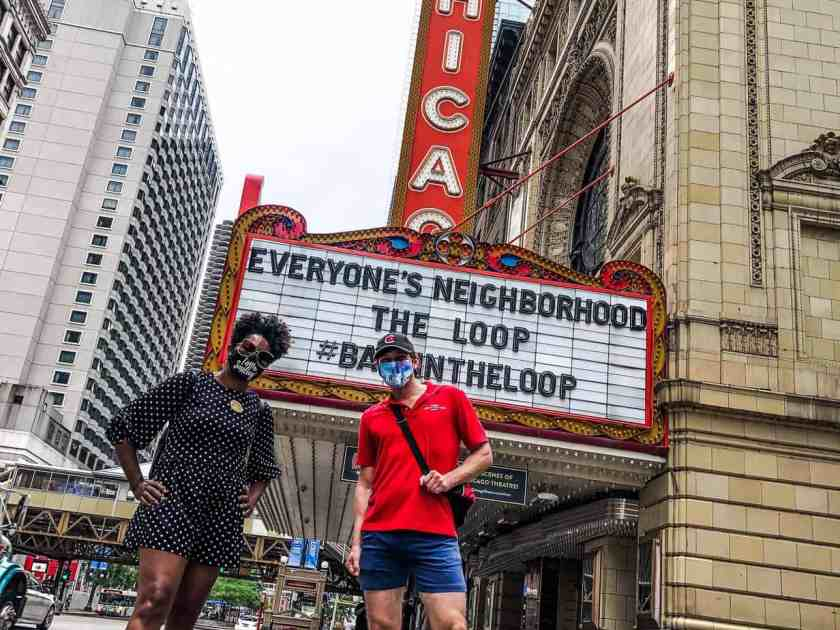 Man and woman standing in front of theatre marquee during Chicago Architecture tour