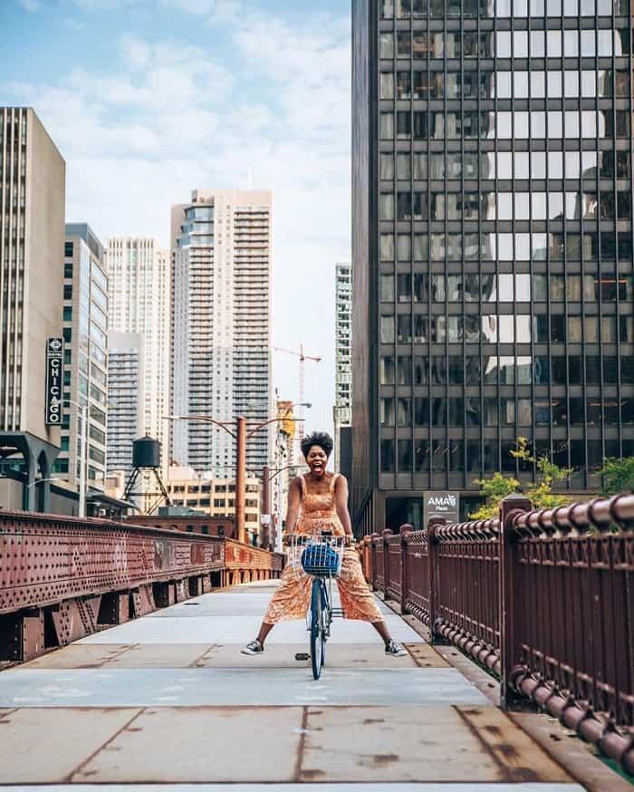 Woman standing next to bike on State Street Bridge