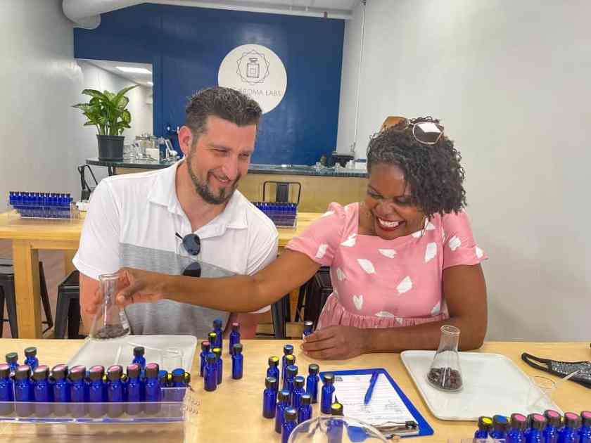 couple making perfume at the Aroma Labs in Downtown Kalamazoo, Michigan