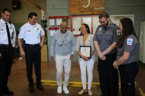 Cobb County Field Supervisor David Beranek, Chief Crider, Mr. Bryson and Tanya give special thanks to 1st Responder Paramedics Logan Rogers and Kayla Williams