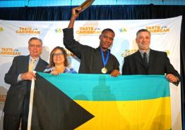 Hazen Rolle of the Bahamas was named Caribbean Junior Chef of the Year. From left is CHTA's CEO Frank Comito, President Patricia Affonso-Dass and judge Peter Olsacher