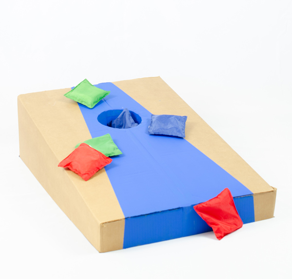 Cornhole game made of cardboard covered with bean bags