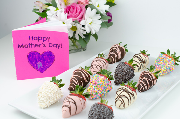 Chocolate covered strawberries with flowers and Mother's Day card