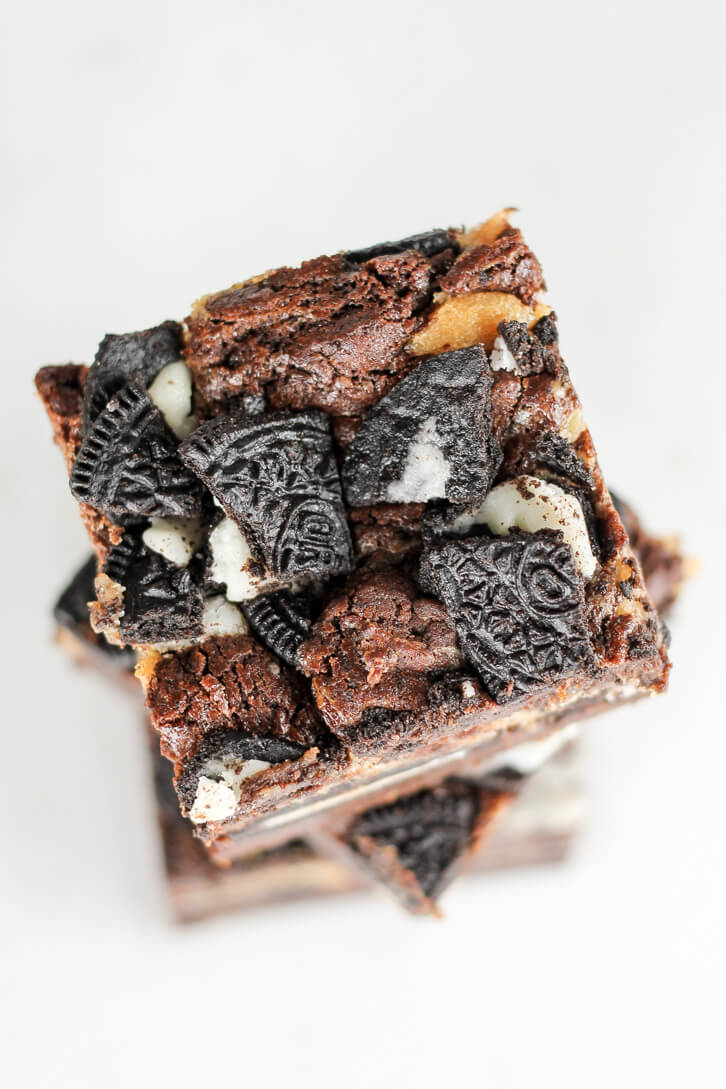 Crumbled Oreo cookies are baked into these peanut butter cheesecake Oreo brownies