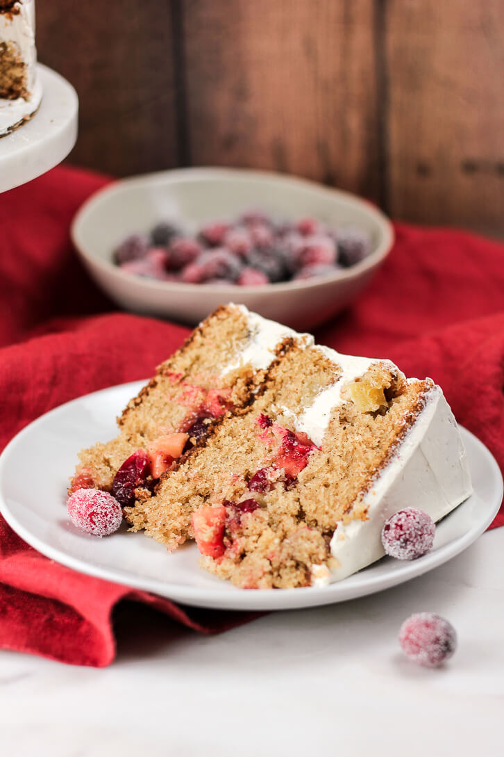 A slice of cranberry apple cake with cranberry apple pie filling