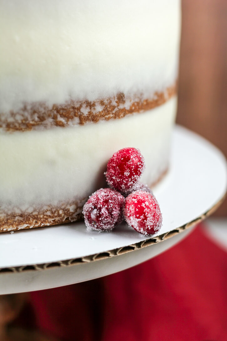 Sugared cranberry garnish on this cranberry apple cake with cream cheese frosting