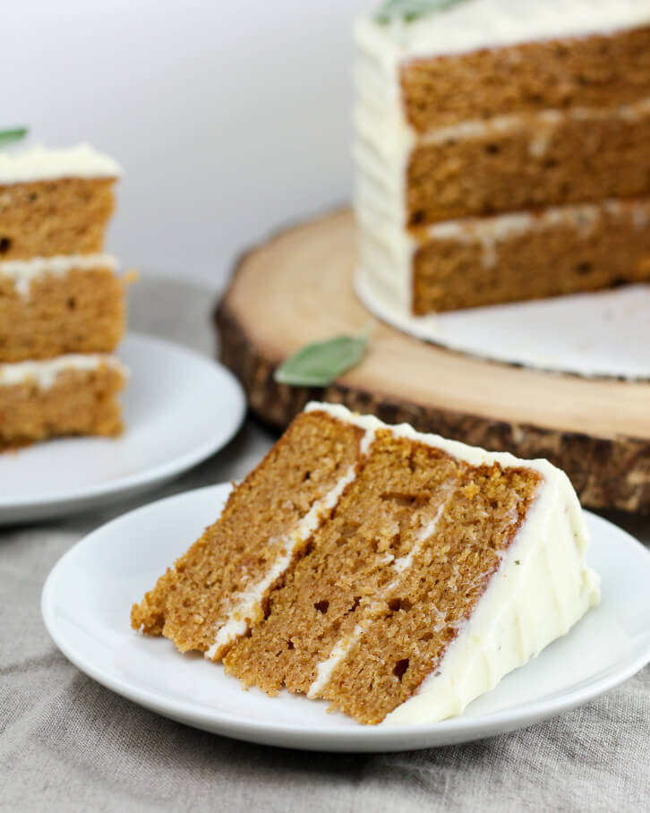 A slice of sweet potato cake with brown butter and fresh sage buttercream