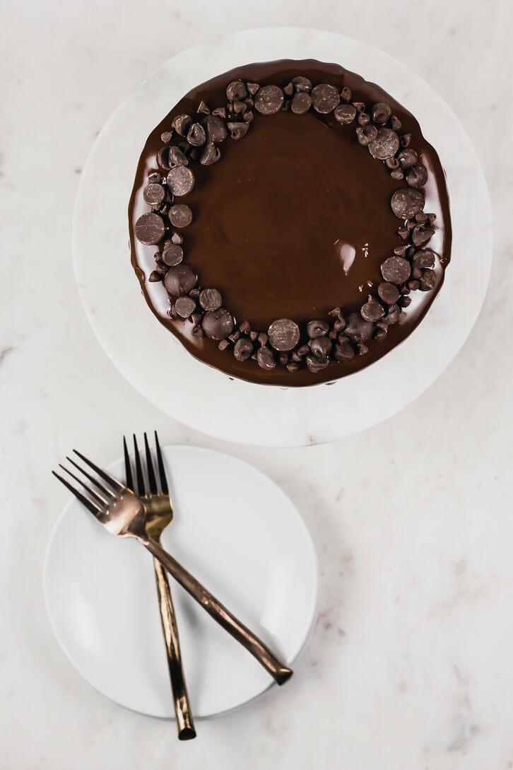 Ultimate gluten-free chocolate cake recipe with chocolate fudge frosting and dark chocolate ganache