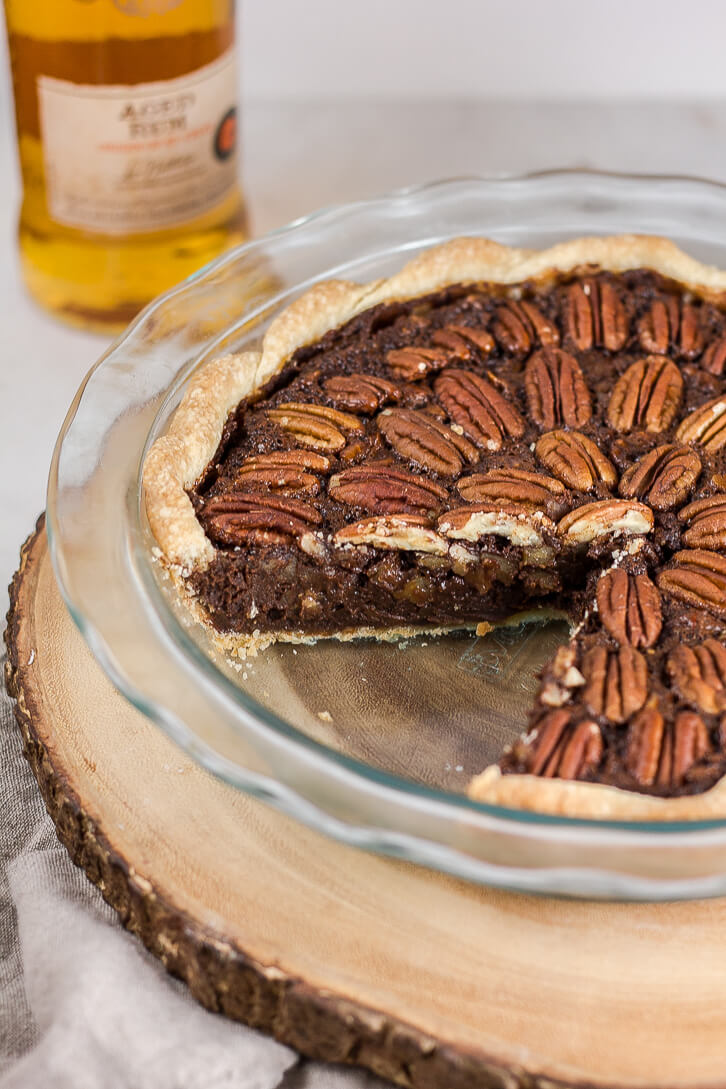 The filling of this chocolate pecan pie recipe gets a little extra kick from a shot of rum