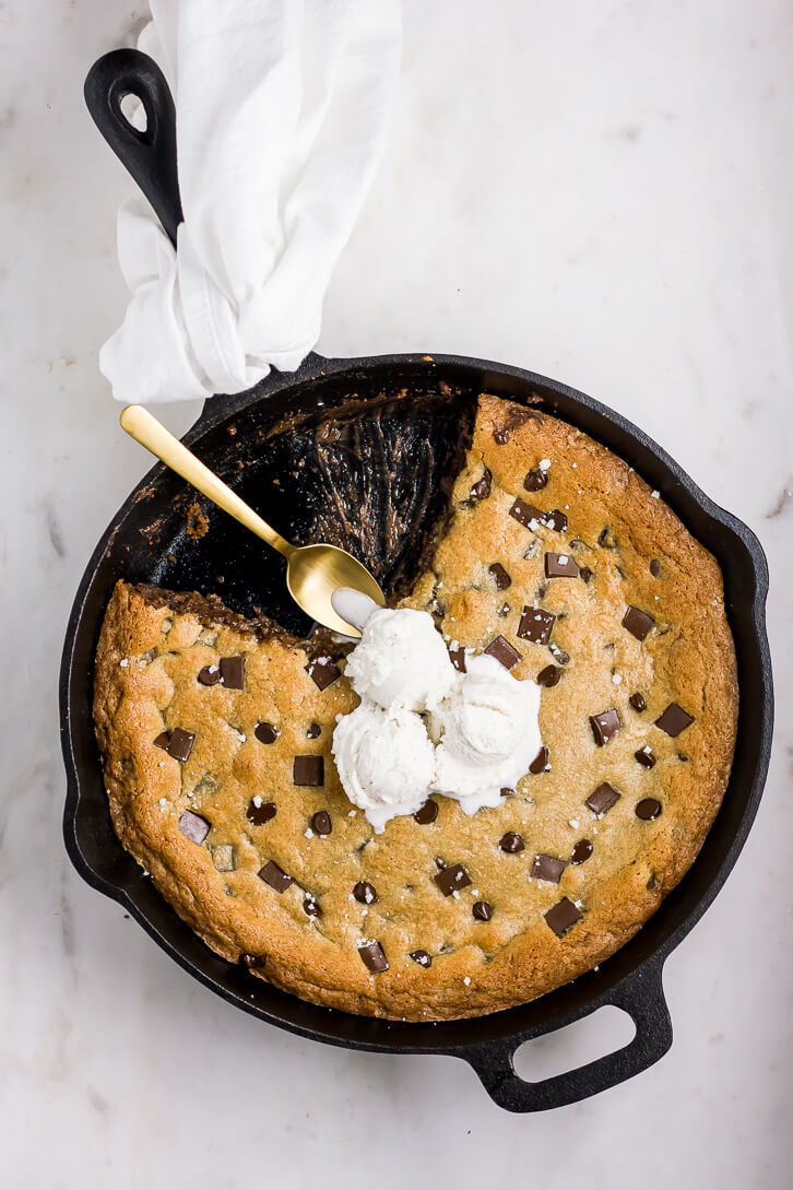 A cast-iron skillet cookie stuffed with chocolate hazelnut spread and sprinkled with flaky sea salt. Golden brown on the edges, but gooey in the center, this giant chocolate chip cookie is the perfect dessert for a crowd. Best served warm with a big scoop of vanilla bean ice cream!
