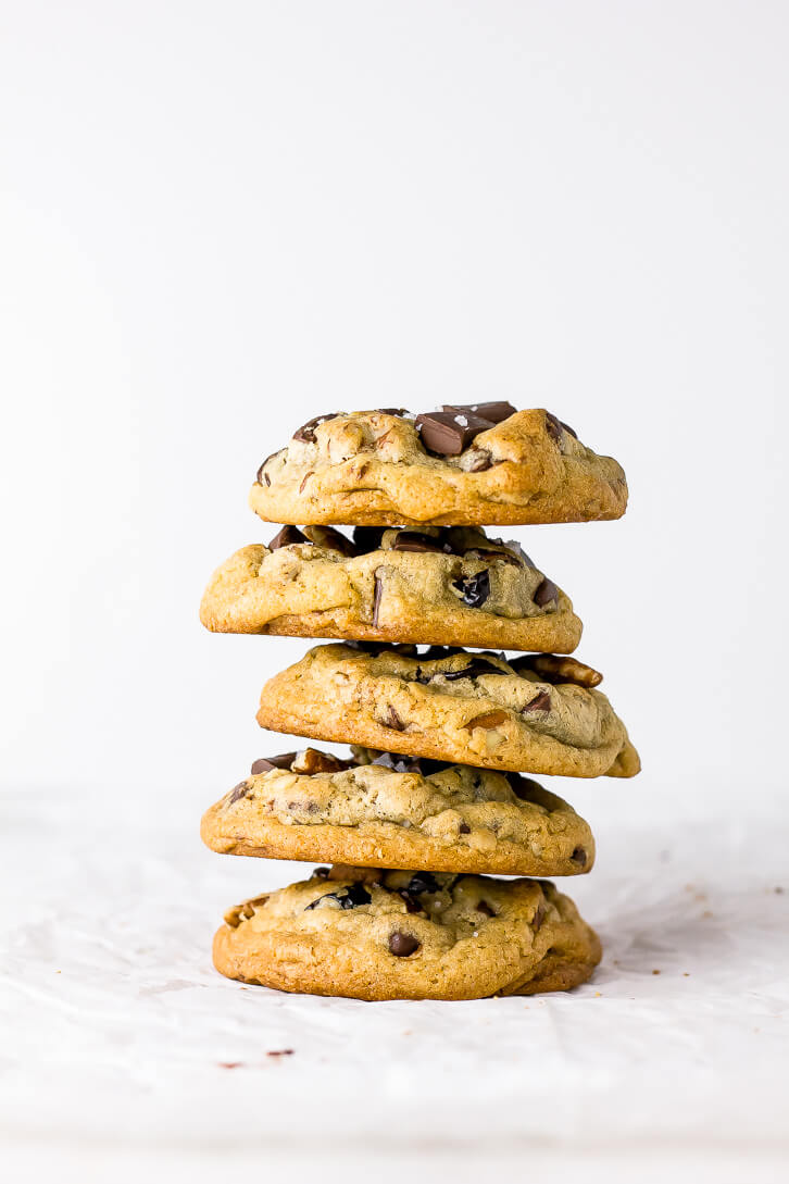 A tall stack of cherry chocolate chip pecan cookies
