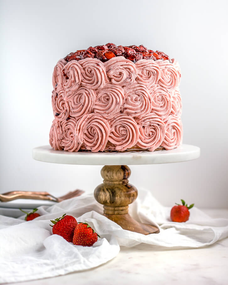 This vanilla cake is frosted with rosettes of balsamic roasted strawberry buttercream