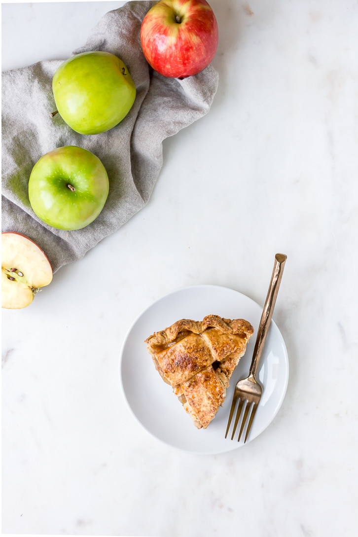 A slice of Bacon Apple Pie with a flaky, cheddar pie crust | Cheddar Bacon Apple Pie | Flour Covered Apron