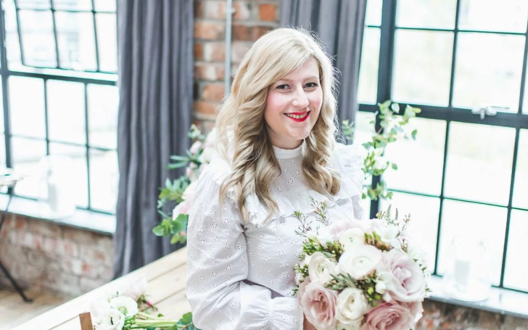 Zoe florist at Flourish and Grace Bristol creates wedding bouquet with roses