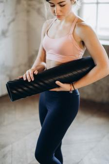 yoga mat and ready for her yoga practice