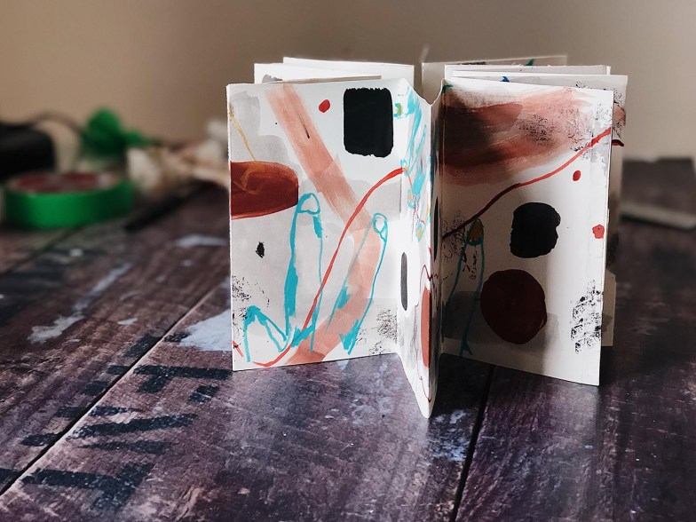 A concertina or accordion sketchbook depicting abstract art