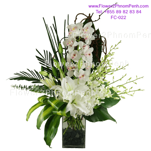 white orchid with white lily in glass vase