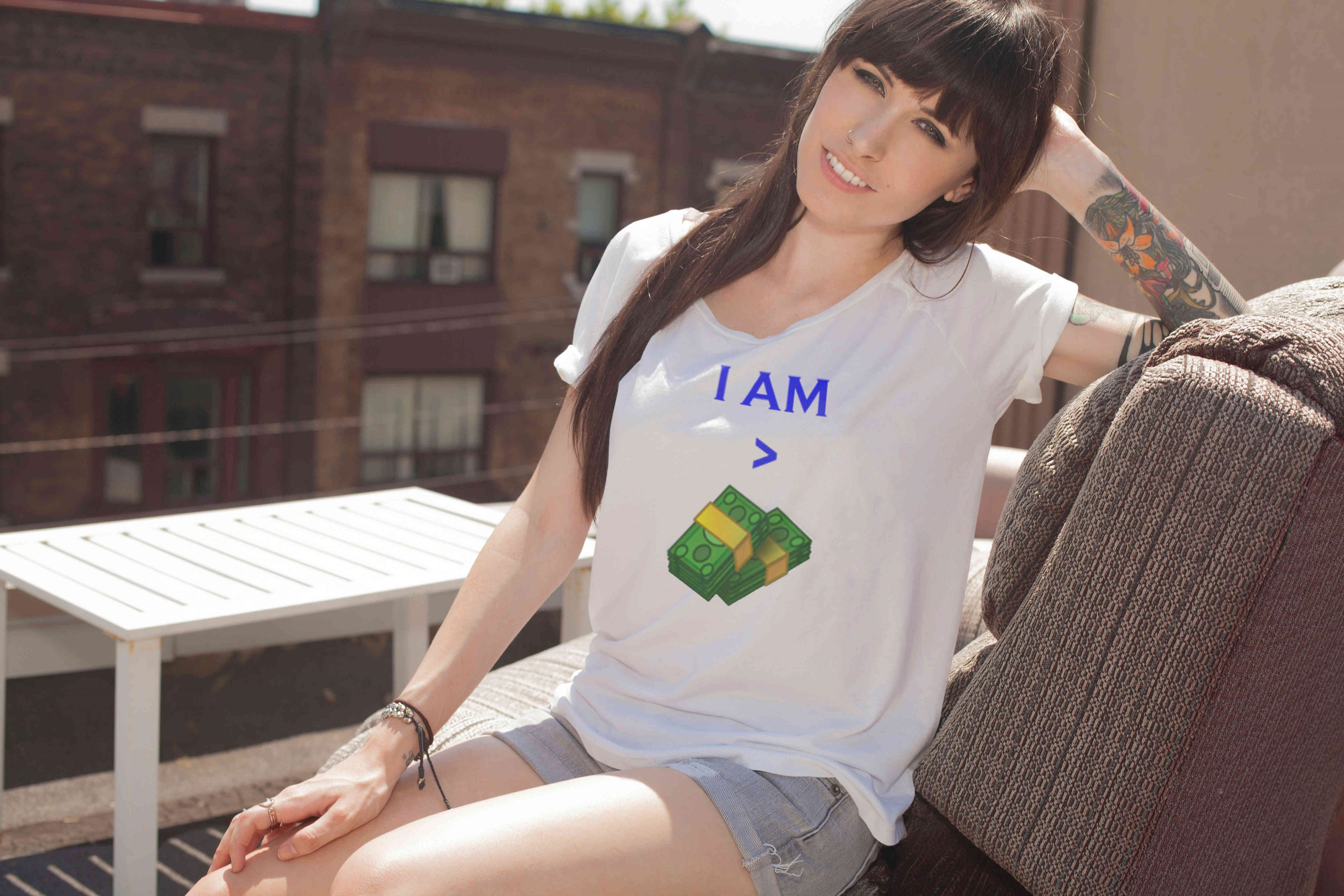 Women with T-shirt showing an inscription that she is greater than Money
