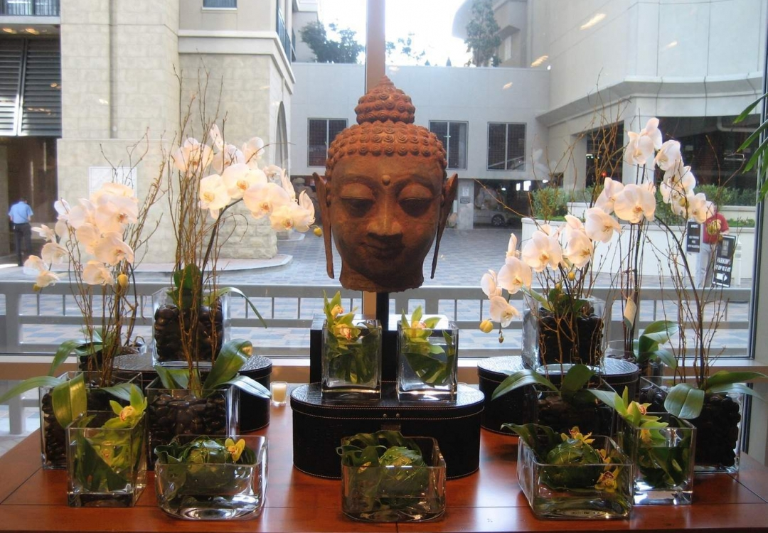 White and green orchids with Buddha