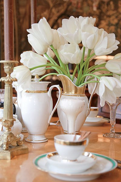 Dunne has to look no further than his shop, Lucullus, for interesting floral containers, including this 19th-century pitcher that holds French tulips. | Photo by Stephen Young