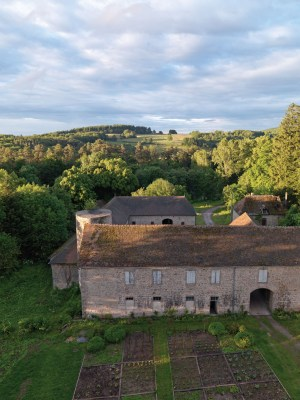 Aerial photo of the French Château Beauvoir surrounded by trees
