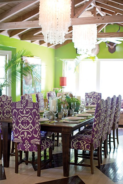 Liza Pulitzer Calhoun's light and colorful dining room features her signature color purple, parrot-green lacquered walls, and floors painted by her sister, Minnie McCluskey.