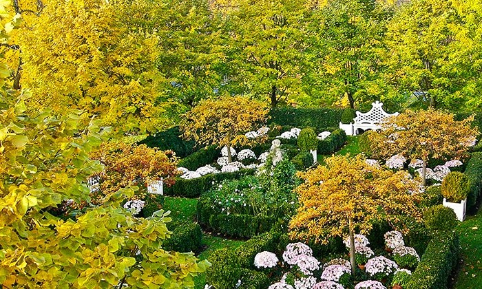 An elevated view of a grid of garden rooms at the home of Carolyne Roehm