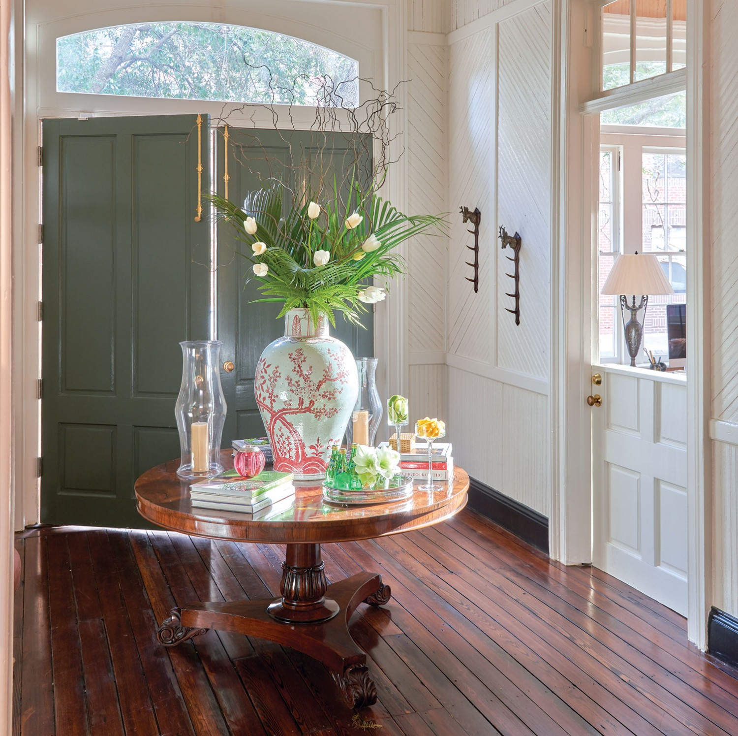 A Regency Table Anchors The Foyer In Tammy Connoru0027s Charleston Design  Studio. She Worked With Lotus Flower To Arrange Palms, Tulips, And Branches  In The ...