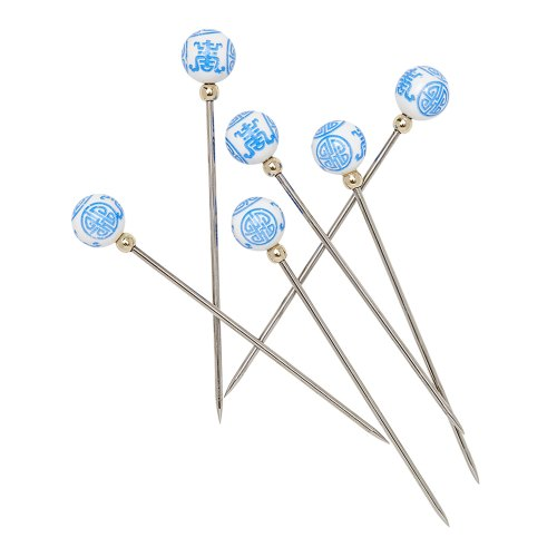Six metal picks topped with a white bead with a blue chinoiserie pattern