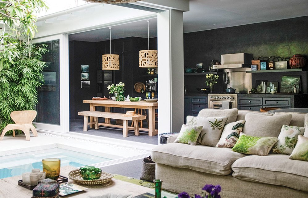 The indoor-outdoor living spaces, including the living room, kitchen, dining areas, and pool, all connect