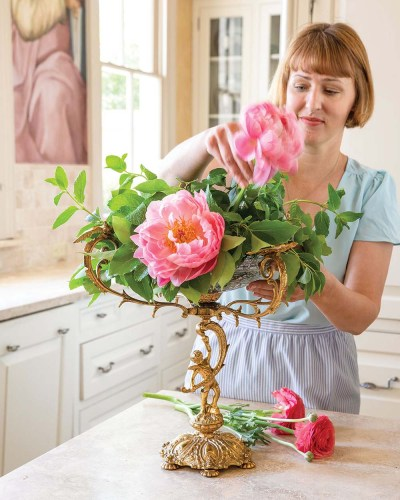 Step 4 photo: Destiny Pinson tucks stems of 'Coral Charm' peonies into the floral arrangment