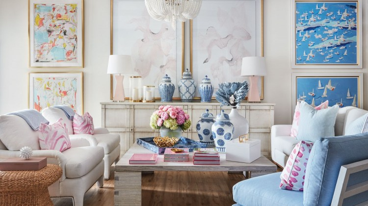The beautifully styled shop invites lingering. Upholstery pieces from LEE, chandelier from Ro Sham Beaux, pink throw pillows from Design Legacy