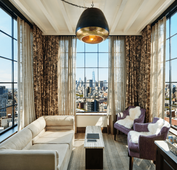 Ludlow hotel suite living area with 3-sided view of New York City skyline